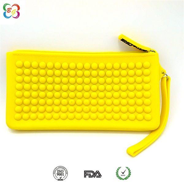 时尚糖果色学生笔袋,纯色硅胶圆珠拉链包,大容量手拿包